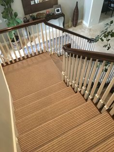 Love the stripe carpet that Hemphill's Rugs & Carpets installed on this set of stairs.