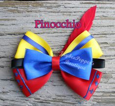Pinocchio inspired hair bow from Hercules. Measures about 4.5 across All bows are made in a smoke free environment and the ends of the bows are heat