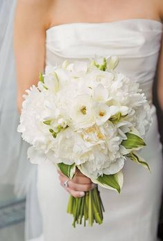 classic all-white bouquet of white ranunculuses and peonies