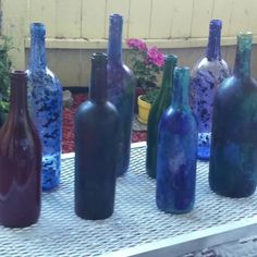 Upcycled wine bottles! Use acrylic paint to give different textures, depth and color patterns.  -clean and dry bottles -mix acrylic paint, small amount of dish soap and Elmer's glue  - sponge paint on outside OR swirl paint INSIDE the bottle  Place in oven for 20mins at 185 degrees. Repeat process for a darker look. (colors will fade slightly in oven.)