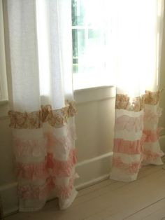 DIY curtains - buy cheap curtains, ruffle strips of fabric, and sew it to the curtains.  Cute!