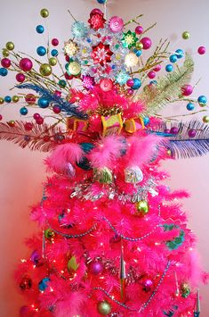 WOW!  Hot Pink Christmas Tree with Colorful Tree Topper pink christmas christmas tree christmas decorations tree topper pink christmas