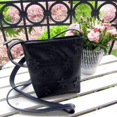 Recycled bike inner tube with hand cut flowers, black vegan.. kr648.00, via Etsy.
