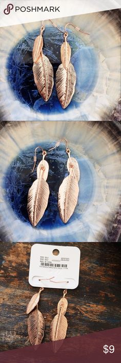 "Faux Rose Gold NWT Metallic Feather Earrings Boho Costume. NWT. Charming Charlie. 4"" from hook.1"" wide. Hypo-allergenic. Host pick! Charming Charlie Jewelry Earrings"
