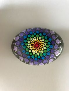 A personal favorite from my Etsy shop https://www.etsy.com/listing/476559770/mandala-stone-hand-painted-rock-dot