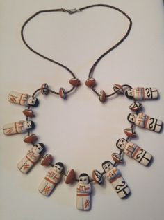 This beautiful Native American Story Teller Necklace is a true work of art.  The brown Heishi shell beads are the finest & tiniest I have EVER seen. Amazingly smooth to the touch. Hand made pottery figures are a treat for the eyes.  27 in length  Originally purchased from an estate sale by the previous owner.