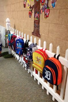 A fence for holding backpacks ~ Adorable!