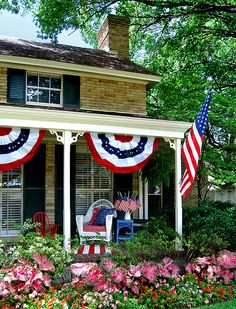 Patriotic Porch with pretty caladiums.  Caladiums are the pink leafy plants.  They are annuals.