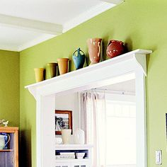 Over-the-Door Shelf...Over-the-Door Shelf  Top a passageway between rooms with a wide ledge for display. This long shelf puts a colorful pottery collection on view and draws the eye upward, emphasizing the kitchen's tall ceiling.