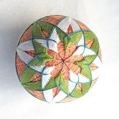 Temari Ball Ornament Japanese Thread Ball Handmade Collectible Christmas Decor Wrapped in a Take-Out Box. $30.00, via Etsy.