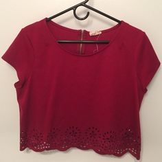 Maroon crop with floral cut outs Perfect condition. Worn once. Good quality material with cute cut outs at the bottom. Originally bought from Urban Outfitters. Pins & Needles Tops Crop Tops