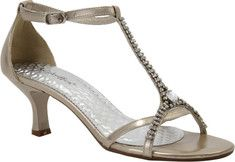 Stick your toes into these rhinestone embellished t-strap sandals and head off to the ball of your dreams. Featuring an adjustable ankle strap, fashionable covered heel, manmade sole and upper.From the last hole to the buckle on a size 7 it is approximately 10.5 inches long.