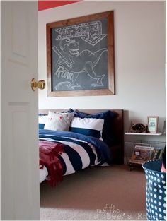 Love the frame on this chalkboard. Would be easy to DIY inexpensively with some baseboards, stain or paint,  chalkboard paint.//boys room justthebeesknees