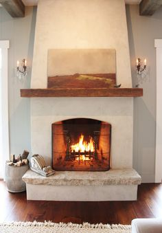 Living room fireplace redo - for the love of a house: I like how the mantel wraps around the side as well as the stucco finish. Very simple. Adobe Fireplace, Stucco Fireplace, Fireplace Remodel, Fireplace Surrounds, Fireplace Design, Simple Fireplace, Fireplace Hearth, Fireplace Facing, Country Fireplace
