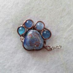 Paw Charm made in memory of Bear Dog. Copper wire wrapped around glass beads with flat Swarovski crystal.