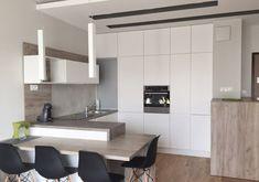 plan de travail cuisine en béton ciré, bar en stratifié et armoires blanches