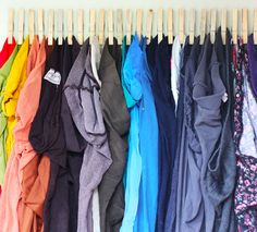 Hang tights or scarves by gluing a bunch of clothes pegs to a piece of wood and then hanging it on your wall or on the back of a closet door.
