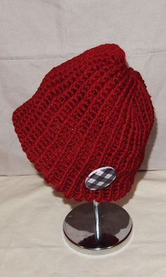 Knitted with round loom .