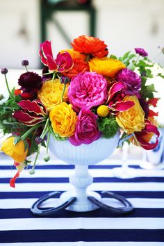 GORGEOUS and well designed centerpiece....rich, saturated and classy...  stripes, horseshoes, and whimsical color palette