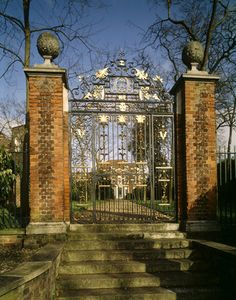The wrought iron Front Gates at Fenton House with initials of Joshua and Anna Gee who lived there from 1706-1730, with House in background.Gates maybe influenced by great ironworker Jean Tijou