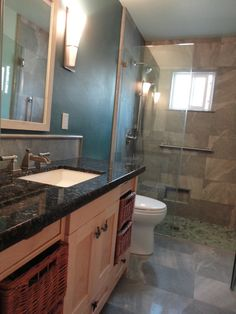 """White under-mount bathroom sink"" Beach Bathroom by Kitchen & Bath Works, San Luis Obispo - www.kandbworks.com"