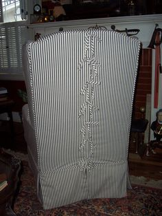 Wing Chair Slipcover in black ticking with ties on back - Bella Slipcovers, Custom Sewing & Design Studio
