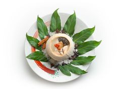 Double boiled Morel mushrooms and wild bamboo pith with tender chicken in milky broth, served in a young coconut. One of the dishes you can expect when you embark on a celebrity food trail with Chef Sam and Forest Leong this October and taste the best of Ocean Restaurant by Cat Cora, Forest森 and Tangerine.