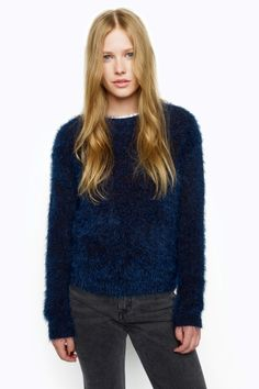 The quintessential fluffy sweater! Soft, furry texture with a nice, shine surface, crew neck.