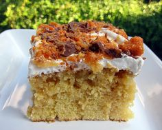 Butterfinger cake: bake a yellow cake, poke holes in it while still warm, pour a can of sweetened condensed milk over, then a jar of smuckers caramel ice cream topping. Cool, spread with Whipped Cream and sprinkle with crushed Butterfinger.