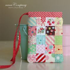 postage stamp patchwork pouch by nanaCompany, via Flickr