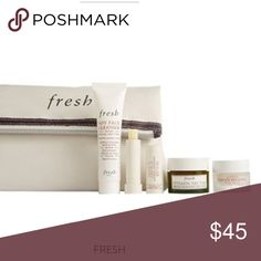 Fresh 5 piece beauty bundle a signature cosmetics bag and deluxe samples of Soy Face Cleanser (0.6 oz.), Sugar Advanced Therapy Lip Treatment (0.07 oz.), Vitamin Nectar Vibrancy-Boosting Face Mask (0.5 oz.) and Lotus Youth Preserve Face Cream (0.24 oz.) fresh Makeup