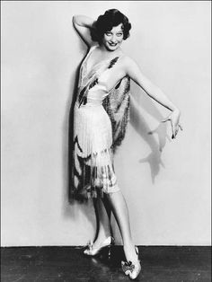 1920s Flappers | Joan Crawford models a flapper dress. The emphasis of flapper fashion ...