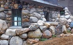 the stone wraps around the house into a fireplace, the fireplace was built before the house!