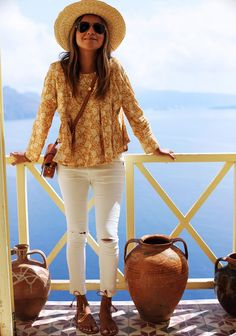 Loving Greece! Top: http://rstyle.me/n/bcidta9sx6 Hat: http://rstyle.me/n/bciduk9sx6 Jeans: http://shopsincerelyjules.com/collections/bottoms/products/wanderer-skinny-jeans-white
