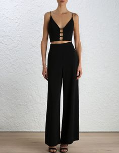 Crepe Link Bodice from our Fall 16 collection, in Black stretch crepe. Circle gold metal link detail throughout the centre front and side of bodice. Plunge V neckline, shoestring straps and centre back zip closure..