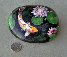 Koi rock painting...beautiful ************************************************ (repin) - #koi #rock #painting - pinning to stone crafts + garden decor boards
