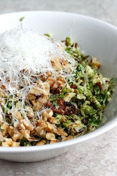 A warm bacon and brussels sprouts shredded salad tossed with chopped walnuts and fresh parmesan. So tasty, and can be served as a side or main meal!