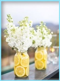 Lemons inside a mason jar of flowers! (I would have different flowers maybe)
