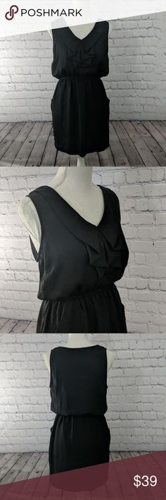 Urban Outfitters Silence + Noise Ruffle Dress Urban Outfitters Silence & Noise Black Ruffle Front Dress  Pre Owned/Great Condition.   Color: Black Size: Medium  Exude elegance in this beautifully draped ruffle front silk dress. Layer it over tights or leggings - or dare to keep your legs bare  Urban Outfitters Silence and Noise Black Ruffle Front Silk Dress Urban Outfitters Dresses Mini