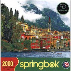 Mediterranean Waterfront 2000 Piece Puzzle: Varenna, Italy sits on the water surrounded by shades of brilliant Italian blues and vibrant Mediterranean greens. The bright red and marigold stucco of a village sitting at the bottom of a mountain makes Mediterranean Waterfront full of patterns and color that just won't quit.  http://www.calendars.com/Assorted-Europe/Mediterranean-Waterfront-2000-Piece-Puzzle/prod201400000278/?categoryId=cat00712=cat00712