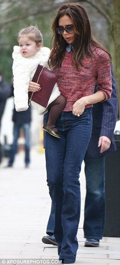 Chilly temperatures: Victoria wore a thin jumper with her bell-bottomed jeans as she headed out in the capital