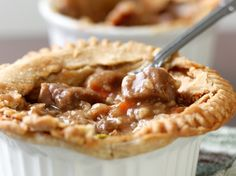 This hearty pot pie features pot roast as the main ingredient. Combine the delicious tastes of a traditional pot pie with the flavorful tastes of a pot roast for dinner. Steak And Kidney Pie, Leftover Roast Beef, Beef Pot Pies, Shops, Stuffed Mushrooms, Stuffed Peppers, Best Comfort Food, Pie Recipes, Recipies