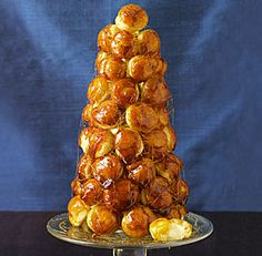 Salty Caramel Croquembouche with Ricotta Cream recipe(watch the video on how to assemble)- I did a short cut and bought already made, frozen cream puffs. This is so fun to decorate. Also another tip: hot glue your cone to the serving plate to keep it in place.