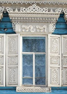 Harmony in Blue & White - Russian decorated window frame with window shutters against blue painted woodden wall. Wooden Architecture, Russian Architecture, Architecture Details, Wooden Windows, Old Windows, Windows And Doors, Window Shutters, Window Frames, Ukraine