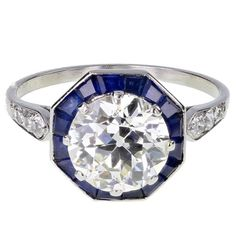 Art Deco Solitaire Diamond Calibre Cut Sapphire Platinum Ring | From a unique collection of vintage solitaire rings at https://www.1stdibs.com/jewelry/rings/solitaire-rings/