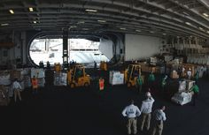 US_Navy_060615-N-7526R-072_Deck_and_Supply_Department_personnel_work_to_move_cargo_in_the_hangar_bay_of_the_Nimitz-class_aircraft_carrier_USS_Ronald_Reagan_(CVN_76)_during_an_underway_replenishment_(UNREP)_with_the_fast_combat_.jpg (3008×1960)