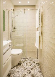 Narrow bathroom with cream tiles