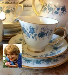 "Hyacinth's china pattern, described as ""Royal Doulton with the hand-painted periwinkles"", is a pattern called ""Braganza"" and was manufactured by The Colclough China Company until 1992."
