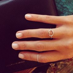 Thin rings and nude mani