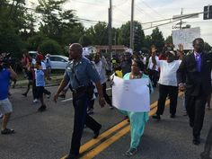 @JamilSmith: Capt. Ron Johnson of the Missouri Highway Patrol walks along with the Ferguson march. Compare this to Wednesday.